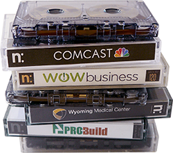 Image of four cassettes: Comcast, WOW business, Wyoming Medical Center, and ProBuild